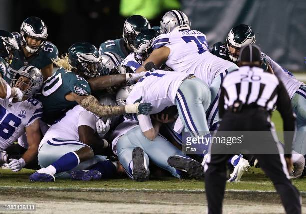 Quarterback Ben DiNucci of the Dallas Cowboys pushes forward with the ball for the first down against the Philadelphia Eagles in the fourth quarter...