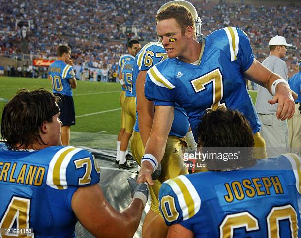 UCLA quarterback Ben Olson shakes hands with linemen Noah Sutherland and Chris Joseph during 3110 victory over Utah in nonconference game at the Rose...