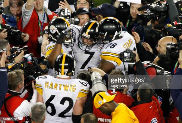 Quarterback Ben Roethlisberger, Max Starks and Justin Hartwig of the Pittsburgh Steelers celebrates after the Steelers won 27-23 against the Arizona...