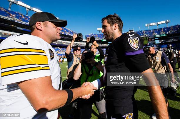 Quarterback Ben Roethlisberger of the Pittsburgh Steelers and quarterback Joe Flacco of the Baltimore Ravens talk after a game at MT Bank Stadium on...