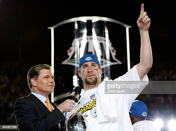 Quarterback Ben Roethlisberger of the Pittsburgh Steelers celebrates with the Vince Lombardi trophy as he is interviewed by Dan Patrick from NBC...