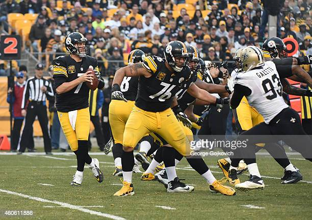 Quarterback Ben Roethlisberger of the Pittsburgh Steelers drops back to pass as offensive linemen Mike Adams and David DeCastro block linebacker...