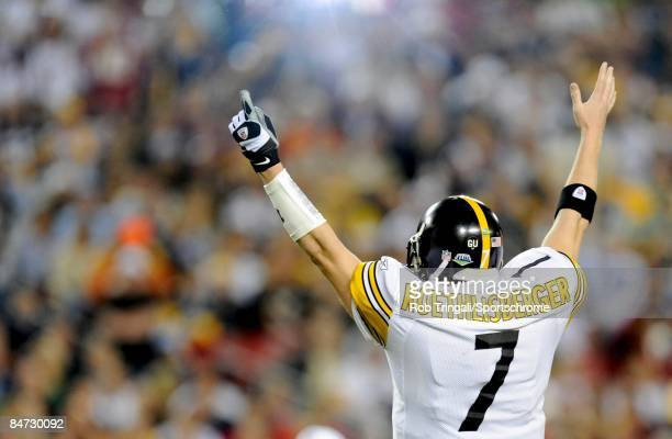 Quarterback Ben Roethlisberger of the Pittsburgh Steelers gestures a touchdown signal against the Arizona Cardinals during Super Bowl XLIII on...