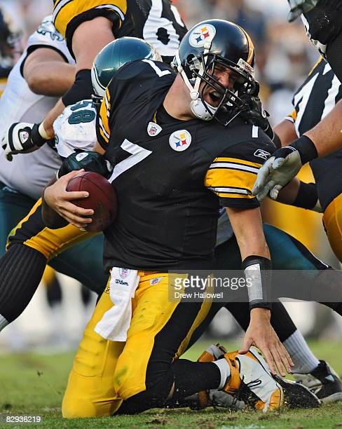 Quarterback Ben Roethlisberger of the Pittsburgh Steelers gets pulled down by his facemask by defensive end Trent Cole of the Philadelphia Eagles on...