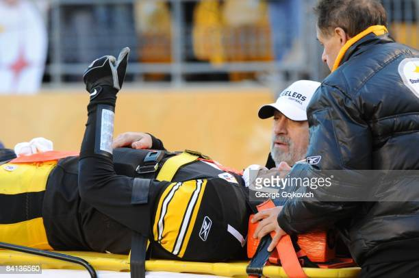 Quarterback Ben Roethlisberger of the Pittsburgh Steelers gives a thumbs up signal as he is carted off the field after he was injured during a game...