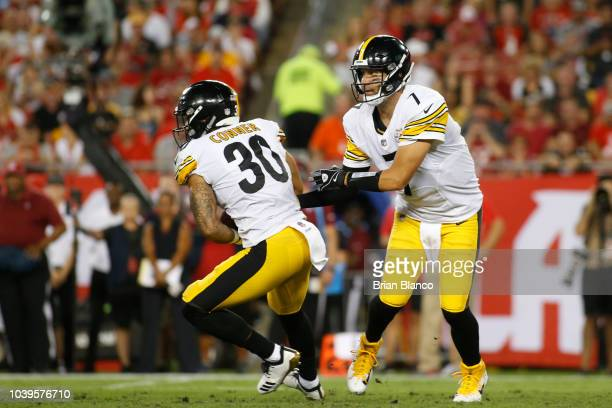 Quarterback Ben Roethlisberger of the Pittsburgh Steelers hands off to running back James Conner during the first quarter of a game against the Tampa...