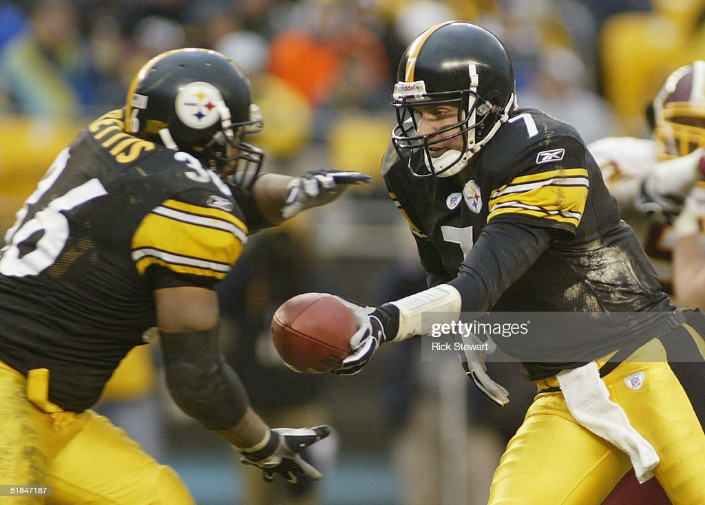 Quarterback Ben Roethlisberger #7 of the Pittsburgh Steelers hands-off the ball to Jerome Bettis #36 during the game against the Washington Redskins on November 28, 2004 at Heinz Field in Pittsburgh, Pennsylvania. The Steelers defeated the Redskins 16-7.