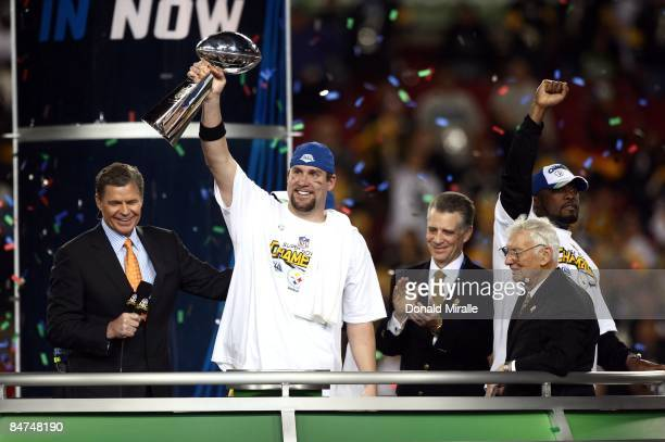 Quarterback Ben Roethlisberger of the Pittsburgh Steelers hoists the Lombardi Trophy after his team's 27-23 victory over the Arizona Cardinals during...