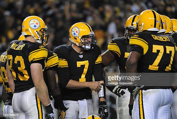 Quarterback Ben Roethlisberger of the Pittsburgh Steelers huddles with the offense including tight end Heath Miller and offensive lineman Marcus...