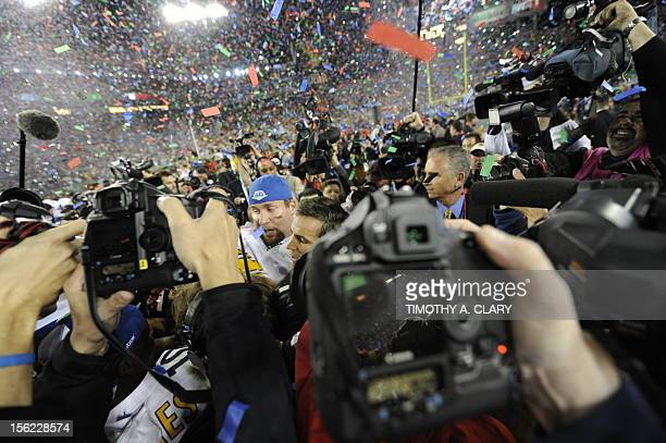 Quarterback Ben Roethlisberger of the Pittsburgh Steelers is surrounded by the media following their victory over the Arizona Cardinals in Super Bowl...