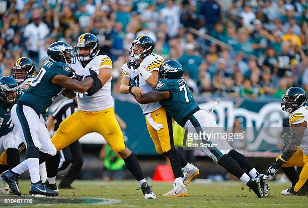 Quarterback Ben Roethlisberger of the Pittsburgh Steelers is hit by Vinny Curry of the Philadelphia Eagles just after throwing an incomplete pass in...