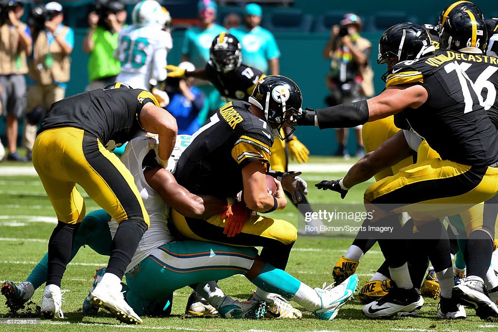 Quarterback Ben Roethlisberger #7 of the Pittsburgh Steelers is sacked by Andre Branch #50 and Cameron Wake #91 of the Miami Dolphins during a NFL game on October 16, 2016 at Hard Rock Stadium in Miami Gardens, Florida.