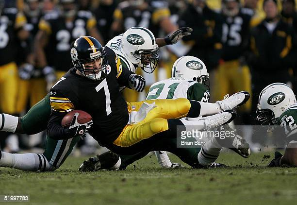 Quarterback Ben Roethlisberger of the Pittsburgh Steelers is tripped up against the New York Jets in an AFC divisional game at Heinz Field on January...