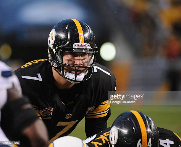 Quarterback Ben Roethlisberger of the Pittsburgh Steelers looks on from the line of scrimmage as he stands behind center Doug Legursky during a game...