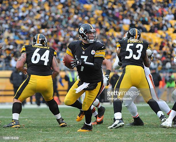 Quarterback Ben Roethlisberger of the Pittsburgh Steelers looks to pass behind the blocking of offensive linemen Doug Legursky and Maurkice Pouncey...