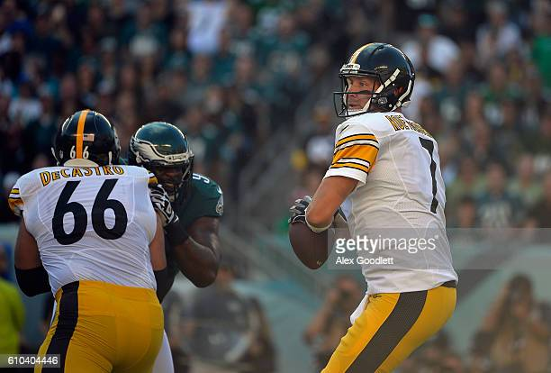 Quarterback Ben Roethlisberger of the Pittsburgh Steelers looks to pass as teammate David DeCastro blocks against the Philadelphia Eagles in the...