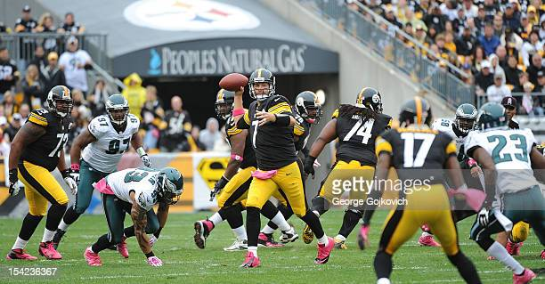 Quarterback Ben Roethlisberger of the Pittsburgh Steelers passes to wide receiver Mike Wallace as defensive linemen Cullen Jenkins Jason Babin and...
