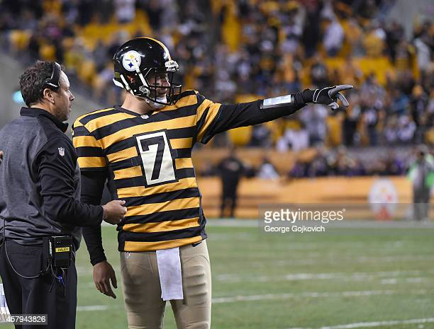 Quarterback Ben Roethlisberger of the Pittsburgh Steelers points as he talks to offensive coordinator Todd Haley during a game against the...