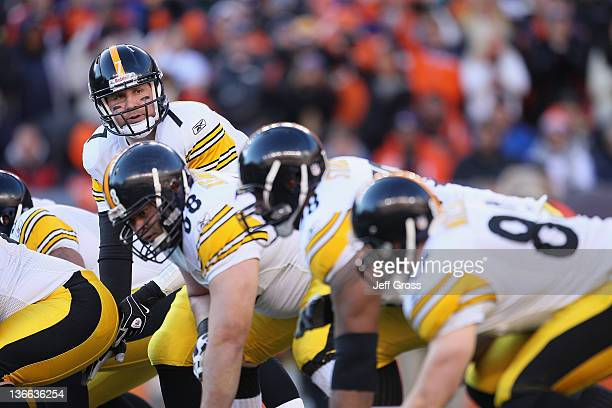 Quarterback Ben Roethlisberger of the Pittsburgh Steelers prepares to take a snap against the Denver Broncos during the Wild Card Playoffs at Sports...