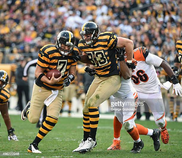 Quarterback Ben Roethlisberger of the Pittsburgh Steelers runs with the football as tight end Heath Miller blocks against the Cincinnati Bengals...