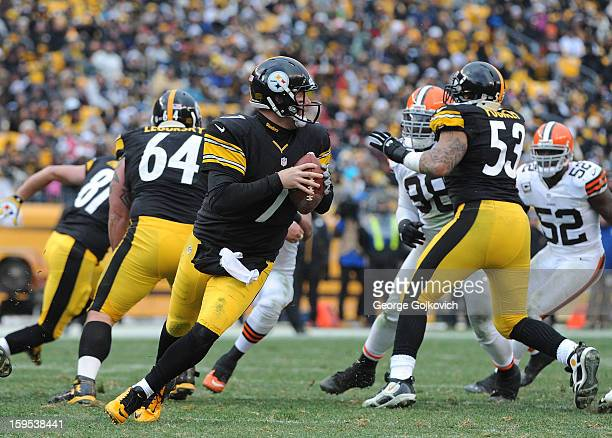 Quarterback Ben Roethlisberger of the Pittsburgh Steelers scrambles as he looks to pass behind the blocking of offensive linemen Doug Legursky and...