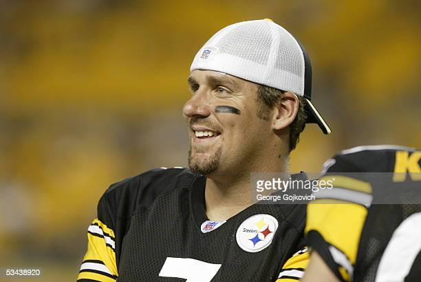 Quarterback Ben Roethlisberger of the Pittsburgh Steelers smiles while talking to teammates on the sideline during a preseason game against the...