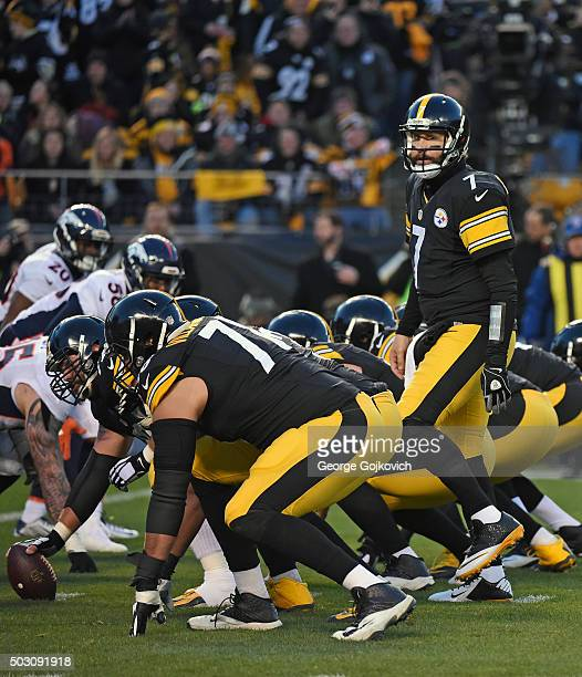 Quarterback Ben Roethlisberger of the Pittsburgh Steelers stands behind the offensive line at the line of scrimmage during a game against the Denver...