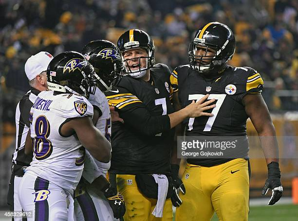 Quarterback Ben Roethlisberger of the Pittsburgh Steelers steps between offensive lineman Marcus Gilbert and linebackers Terrell Suggs and Elvis...