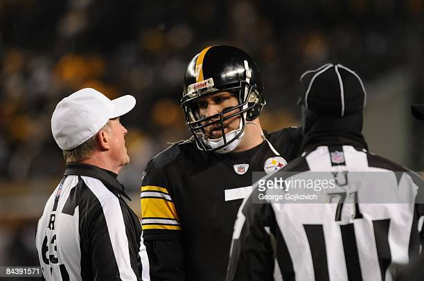 Quarterback Ben Roethlisberger of the Pittsburgh Steelers talks with referee Bill Carollo and umpire Rueben Fowler during the AFC Championship game...