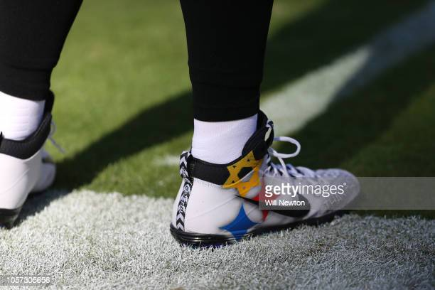 Quarterback Ben Roethlisberger of the Pittsburgh Steelers wears cleats in response to last months mass shooting in Pittsburgh prior to the game...