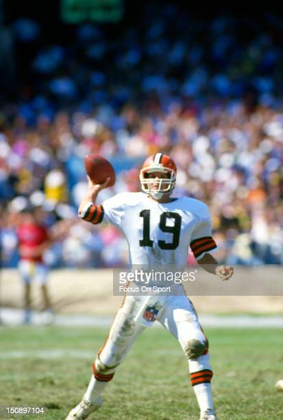 Quarterback Bernie Kosar of the Cleveland Brown drops back to pass against the Pittsburgh Steelers during an NFL football game at Cleveland Municipal...