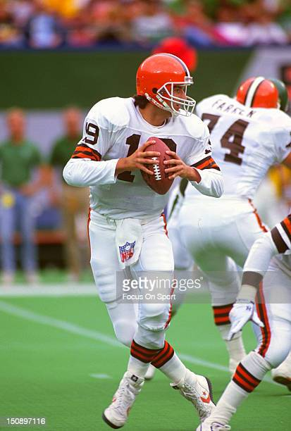 Quarterback Bernie Kosar of the Cleveland Brown drops back to pass against the New York Jets during an NFL football game at The Meadowlands September...