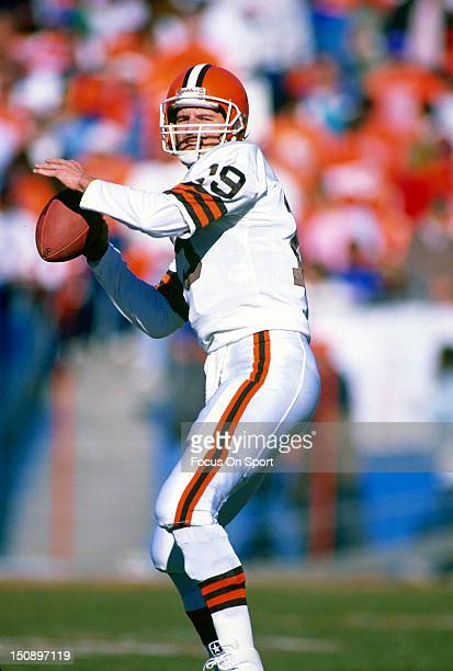 Quarterback Bernie Kosar of the Cleveland Brown drops back to pass against the Denver Broncos during the AFC/NFL Conference Championship game at Mile...