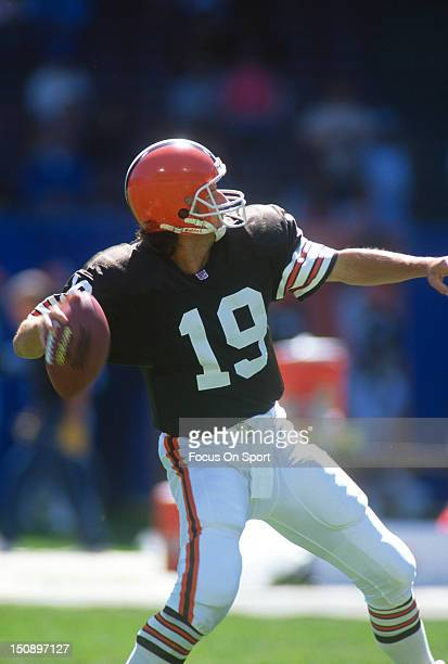 Quarterback Bernie Kosar of the Cleveland Brown drops back to pass against the Dallas Cowboys during an NFL football game at Cleveland Municipal...