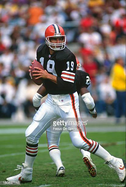 Quarterback Bernie Kosar of the Cleveland Brown drops back to pass against the Washington Redskins during an NFL football game at RFK Stadium October...