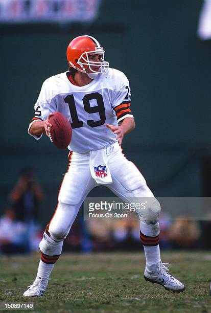 Quarterback Bernie Kosar of the Cleveland Brown drops back to pass against the San Diego Chargers during an NFL football game at Jack Murphy Stadium...