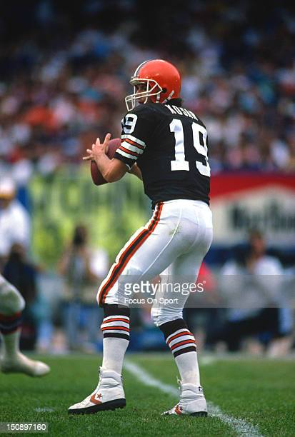 Quarterback Bernie Kosar of the Cleveland Brown drops back to pass during an NFL football game at Cleveland Municipal Stadium circa 1989 in Cleveland...