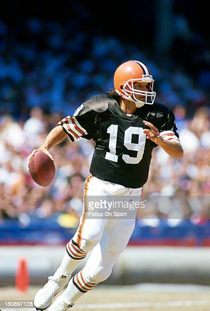 Quarterback Bernie Kosar of the Cleveland Brown rolls out to pass against the Dallas Cowboys during an NFL football game at Cleveland Municipal...