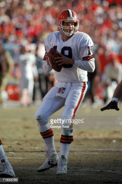 Quarterback Bernie Kosar of the Cleveland Browns looks down field for a receiver during the 1987 AFC Championship game against the Denver Broncos at...