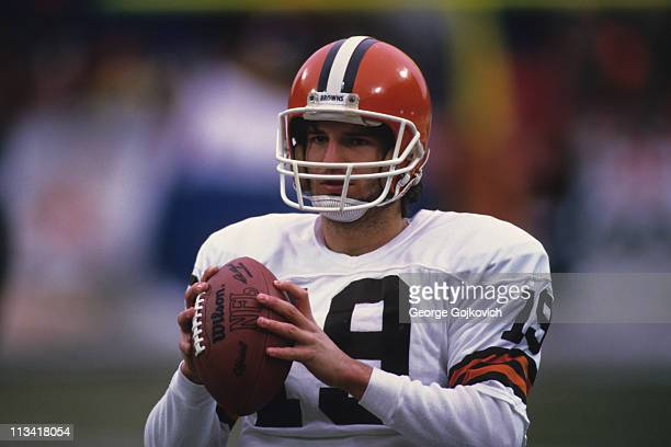 Quarterback Bernie Kosar of the Cleveland Browns looks on from the field before a National Football League game at Municipal Stadium circa 1985 in...