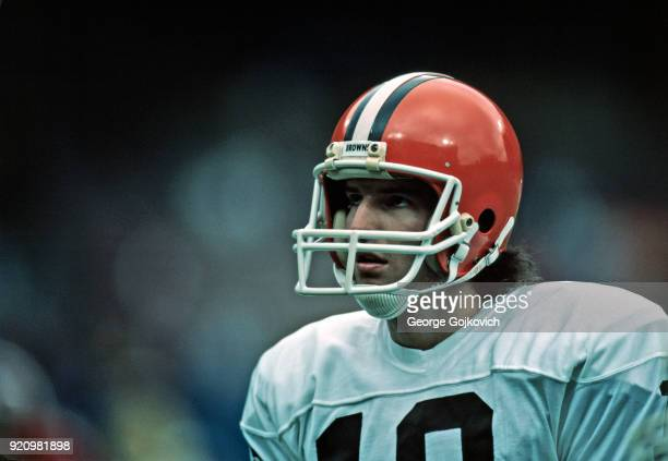 Quarterback Bernie Kosar of the Cleveland Browns looks on from the sideline during a National Football League game at Cleveland Municipal Stadium in...