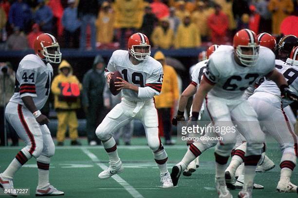 Quarterback Bernie Kosar of the Cleveland Browns looks to pass against the Pittsburgh Steelers behind the blocking of Earnest Byner and Cody Risien...