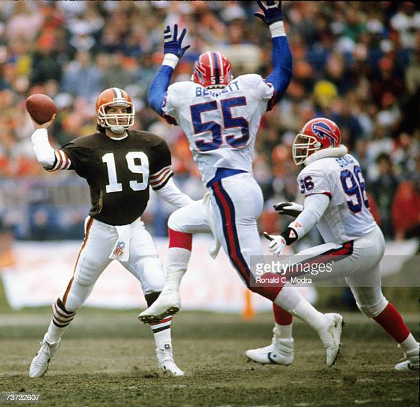 Quarterback Bernie Kosar of the Cleveland Browns passing against the Buffalo Bills during the AFC Divisional Playoff Game on January 6 1990 in...