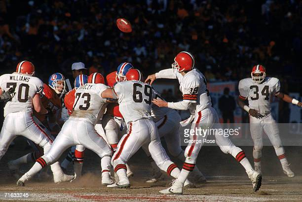 Quarterback Bernie Kosar of the Cleveland Browns releases the ball behind strong protection during the 1987 AFC Championship game against the Denver...