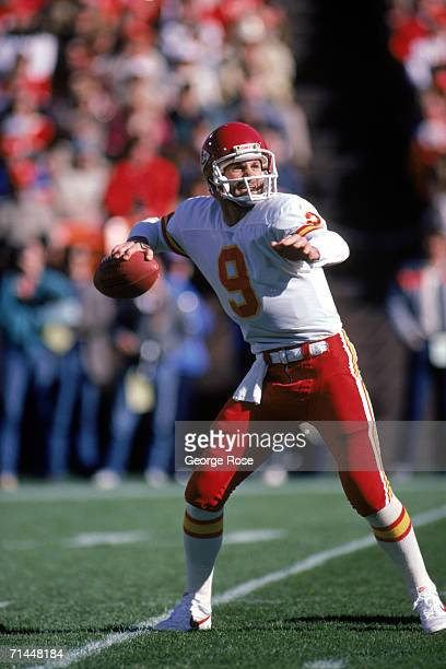 Quarterback Bill Kenney of the Kansas City Chiefs looks to pass during a game against San Francisco 49ers at Candlestick Park on November 17 1985 in...