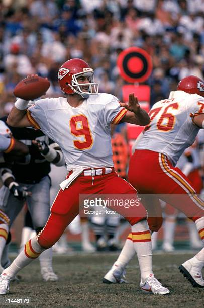 Quarterback Bill Kenney of the Kansas City Chiefs passes during a game against the Los Angeles Raiders at Los Angeles Memorial Coliseum on October 6...