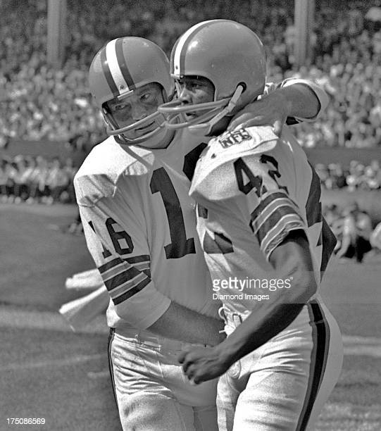 Quarterback Bill Nelsen of the Cleveland Browns congratulates wide receiver Paul Warfield after a touchdown during a game circa 1969 at Cleveland...