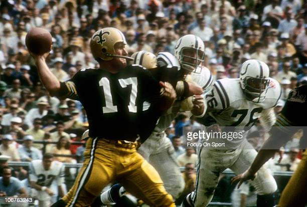 Quarterback Billy Kilmer of the New Orleans Saints drops back to pass against the Baltimore Colts during an NFL football game at Tulane Stadium...