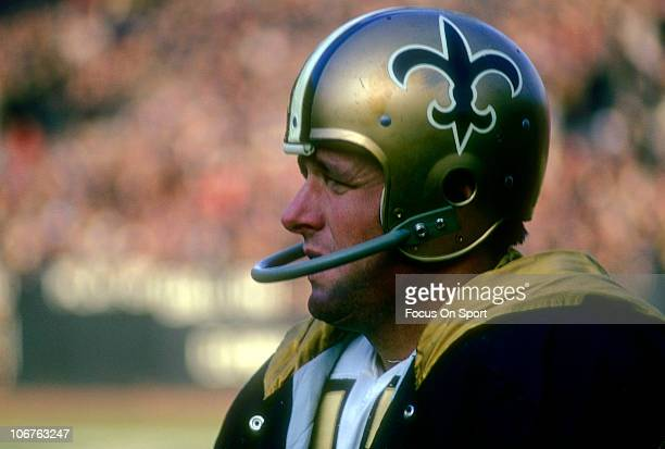 Quarterback Billy Kilmer of the New Orleans Saints looks on from the sidelines during an NFL football game circa 1969 Kilmer played for the Saints...