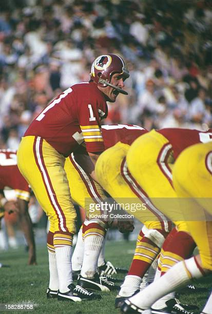 Quarterback Billy Kilmer of the Washington Redskins barks out the signals at the line of scrimmage during Super Bowl VII on January 14 1973 against...